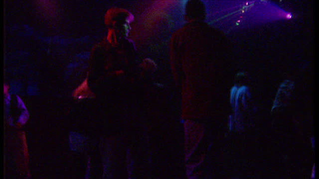 Interior shots of people dancing on the dancefloor at Rhythm Station Nightclub to pop music on January 28 1996 in Aldershot Hampshire England...