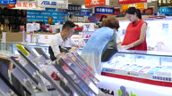 Interior shots of people in Shenzhen shopping for consumer electronics in a large electrical store including Acer laptops on display and various Sony...