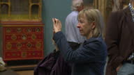 Interior shots of people taking photographs including 'selfies' and looking at paintings in Manchester Art Gallery>> on August 14 2014 in Various...