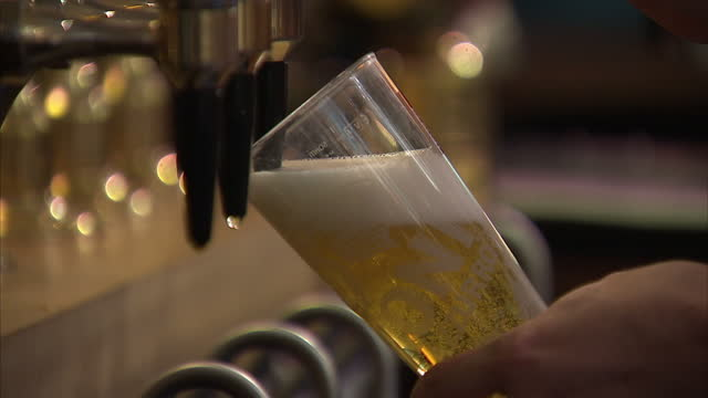 Interior shots of pints of lager being poured in a pub on August 24 2015 in London England