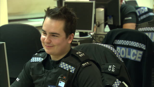 Interior shots of police officers working at desks looking at computer screens checking CCTV on November 17 2014 in Brighton England