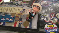 Interior shots of political memorabilia on display in an antique shop including pin badges from various presidential election campaigns