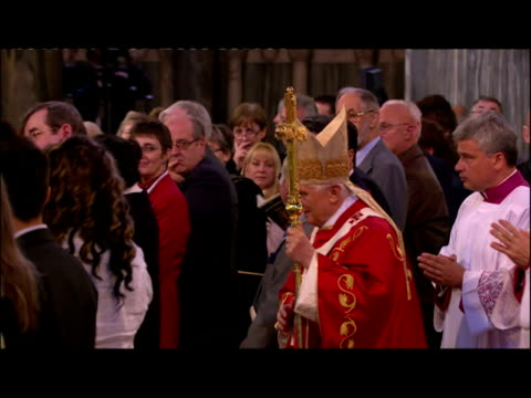Interior shots of Pope Benedict XVI leading procession in Westminster Cathedral before saying mass Interior wide shots of procession and congregation...