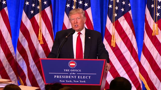 Interior shots of President Elect Donald Trump speaking at a podium during a press conference to refute claims of the existence of a Russian dossier...