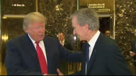 Interior shots of Presidentelect Donald Trump walk out of elevator with CEO of Louis Vuitton Bernard Arnault and shake hands with him for cameras...