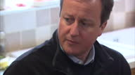 Interior shots of Prime Minister David Cameron speaking with residents affected by flooding in Othery Somerset>> on February 19 2014 in Various...