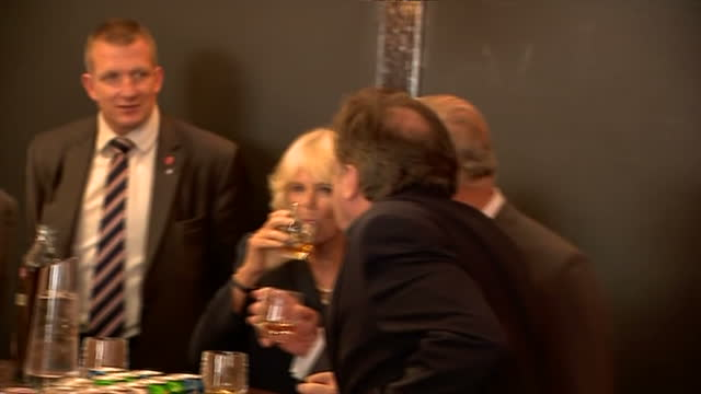 Interior shots of Prince Charles and Camilla Duchess of Cornwall enjoying a glass of whisky while speaking to Alan Crossan owner of the Clutha bar>>...
