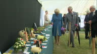 Interior shots of Prince Charles and Camilla Duchess of Cornwall viewing a display of animal sculptures constructed from fruit and vegetables in a...