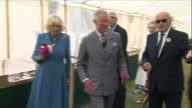 Interior shots of Prince Charles and Camilla Duchess of Cornwall viewing exhibits in a marquee at Sandringham Flower Show and meeting competitors and...