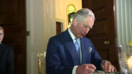 Interior shots of Prince Charles and Camilla Duchess of Cornwall speaking to Matthew Barzun United States Ambassador to the United Kingdom and...