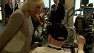 Interior shots of Prince Charles and Camilla Duchess of Cornwall speaking to residents during a tour of gym facilities at the Armed Forces Retirement...