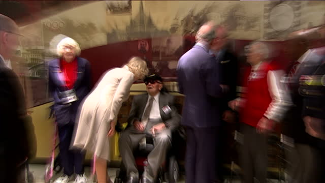 Interior shots of Prince Charles and Camilla Duchess of Cornwall meeting US Armed Forces veterans during a visit to the Armed Forces Retirement Home...