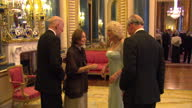 Interior shots of Prince Charles Camilla Duchess of Cornwall greeting Simeon II and Queen Margarita of Bulgaria at the Sovereign dinner Prince...