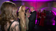 Interior shots of Prince Charles meeting chats with Jerry Hall actor Damien Lewis his wife Helen McCrory on February 04 2016 in London England