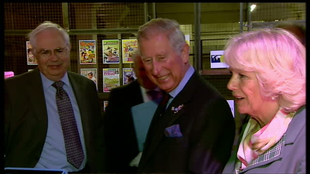 Interior shots of Prince Charles meeting various employees from DC Thomson and Co and speaking to them Charles and Camilla meeting DC Thomson...