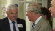 interior shots of Prince Charles Prince of Wales entering room and shake hands with various officials at the East Belfast Network Centre on May 21...