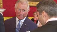 interior shots of Prince Charles Prince of Wales talking to guests at St James' Palace on May 13 2015 in London England