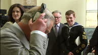 interior shots of Prince Charles Prince of Wales talking to people at stall and putting on a pair of headphones at the East Belfast Network Centre on...