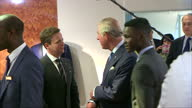 interior shots of Prince Charles Prince of Wales TV personalities Ant Dec talk to young employees in the menswear department before Ant trying on a...