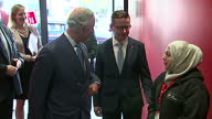interior shots of Prince Charles Prince of Wales walking into Centre and greeting staff during his visit to the Prince's Trust Morgan Stanley Centre...