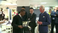 interior shots of Prince Charles Prince of Wales walking into the home department with TV personality Anthony McPartlin 'Ant' and talk to young...
