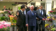 interior shots of Prince Charles Prince of Wales walking through shop with TV personality Anthony McPartlin 'Ant' and briefly look at flowers before...