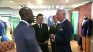 interior shots of Prince Charles Prince of Wales walking through the clothes department and talking to young employees with TV personality Anthony...