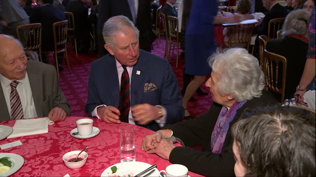 Interior shots of Prince Charles speaking with Holocaust survivors and other guests during Holocaust Memorial Day Trust reception >> on February 09...