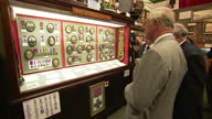 Interior shots of Prince Charles touring the Royal Welsh Regimental Museum and viewing a display of portraits of Victoria Cross recipents from the...