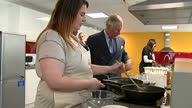 interior shots of Prince Charles watching two girls cooking vegetable talking to them about ingredients and making jokes with Ant McPartlin during...