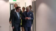 interior shots of Prince Charles wiping his nose as he walks down corridor and then greeting staff during his visit to the Prince's Trust Morgan...