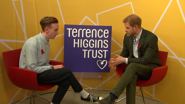 Interior shots of Prince Harry being introduced to a young man and speaking to him about his HIV status during a visit to the Terrence Higgins Trust...