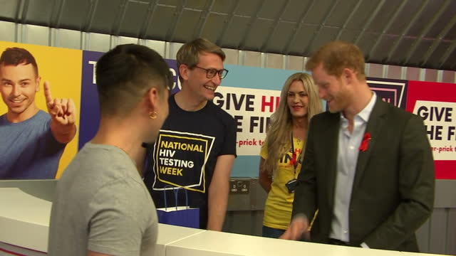Interior shots of Prince Harry helping to hand out HIV testing kits at the Terrence Higgins Trust HIV testing popup shop in Hackney on November 15...