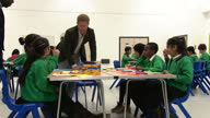 Interior shots of Prince Harry meeting children taking part in the Yes You Can project's 'I Have a Dream' programme during a visit to Hamilton...