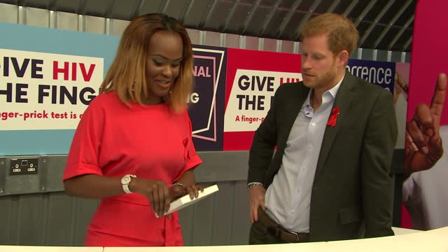 Interior shots of Prince Harry meeting Yvette Twagiramariya during a visit to the Terrence Higgins Trust HIV testing popup shop in Hackney and...