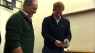 Interior shots of Prince Harry Prince Harry shown how to open a Bluff oyster with the help of islander Jim Barrett of Big Glory Oysters and hands it...