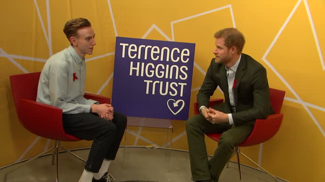 Interior shots of Prince Harry speaking to a young man during a visit to the Terrence Higgins Trust HIV testing popup shop talking about his...