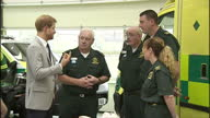 Interior shots of Prince Harry speaking to paramedics and looking at training dummies and other equipment as he visits an ambulance station on...