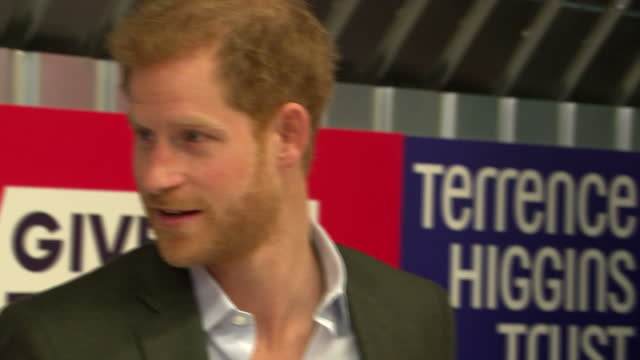 Interior shots of Prince Harry speaking to Yvette Twagiramariya and Terrence Higgins Trust Chief Executive Ian Green about HIV testing and how the...