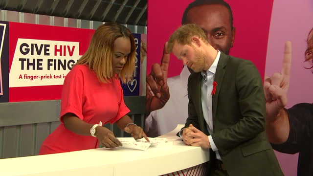 Interior shots of Prince Harry speaking to Yvette Twagiramariya at the Terrence Higgins Trust HIV testing popup shop in Hackney about how the HIV...