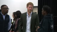 Interior shots of Prince Harry visiting Hamilton Community College and meeting mentors from the Yes You Can project and its 'I Have a Dream'...