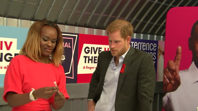 Interior shots of Prince Harry watching Yvette Twagiramariya demonstrate an HIV selftesting kit during a visit to the Terrence Higgins Trust HIV...