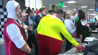 Interior shots of Prince Harry with a group of traders dressed as 'Alice in Wonderland' characters during a charity trading day at ICAP>> on December...