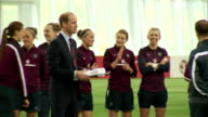 interior shots of Prince William Duke of Cambridge holding a present for Princess Charlotte from the England Women's Football Team and then wave...