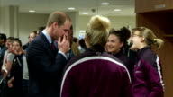 interior shots of Prince William Duke of Cambridge meeting the England Women's Football Team and talk to them about Princess Charlotte pointing to...