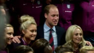 interior shots of Prince William Duke of Cambridge posing for a photo with the England Women's Football Team at St Georges Park on May 20 2015 in...