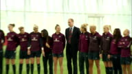 interior shots of Prince William Duke of Cambridge posing for photos with England Women's Football team at St Georges Park on May 20 2015 in...