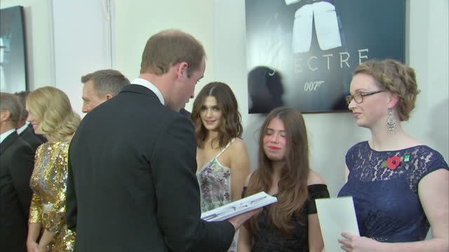 Interior shots of Prince William Duke of Cambridge speaking to guests and receiving gift at the Royal World Premiere of 'Spectre' at Royal Albert...