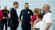 interior shots of Prince William Duke of Cambridge talking to disabled people during his visit to meet the England Women's Football Team at St...