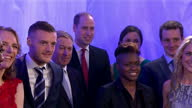 Interior shots of Prince William Duke of Cambridge walk into room and pose for photos with BBC sports personalities of the year nominees including...